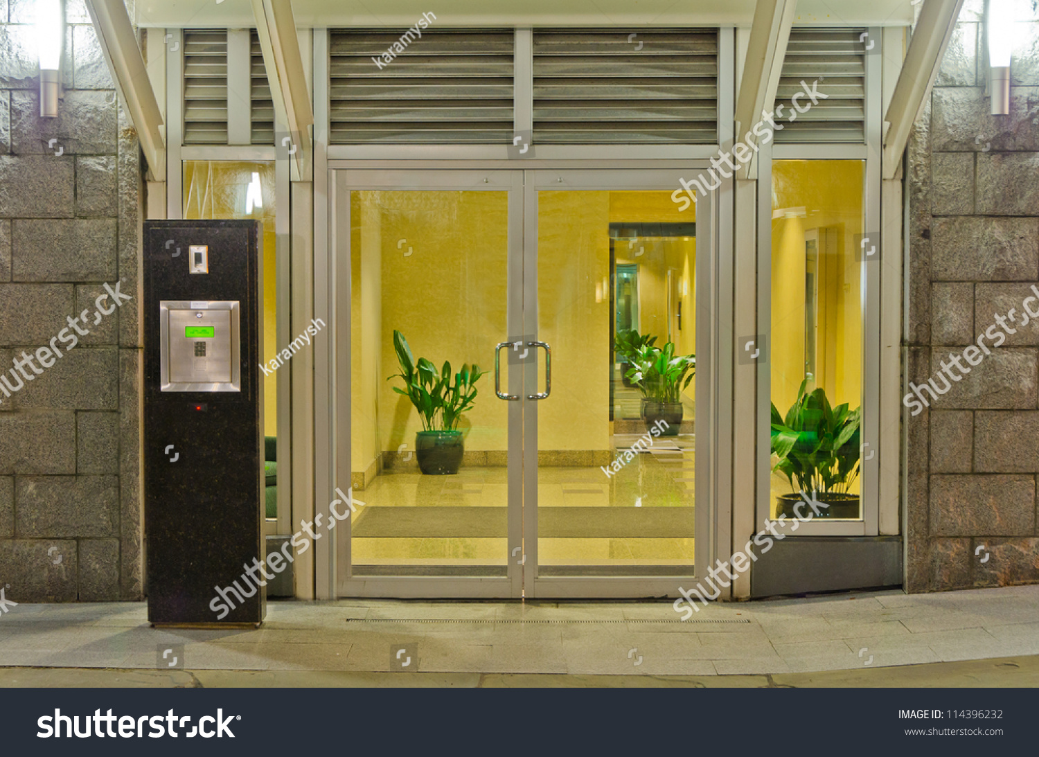 Entrance back door of a building at night stock photo for Back door entrance
