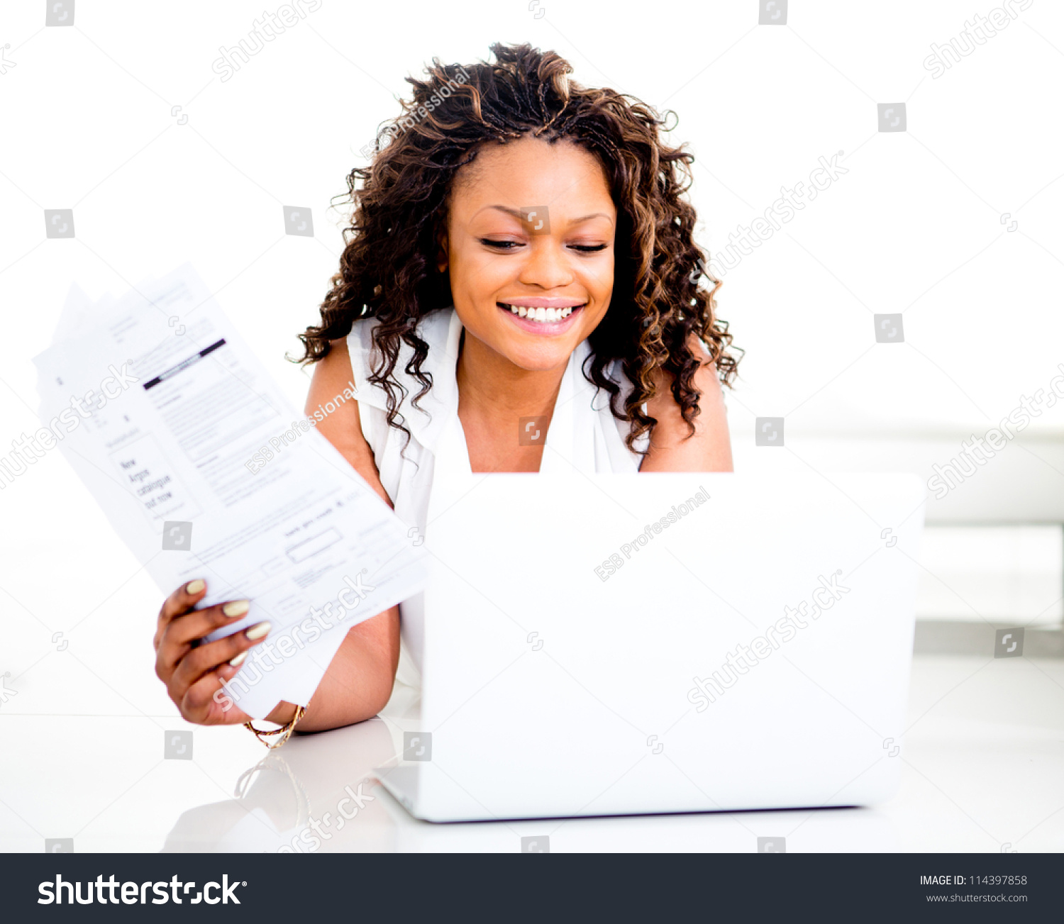 woman paying bills online home smiling stock photo