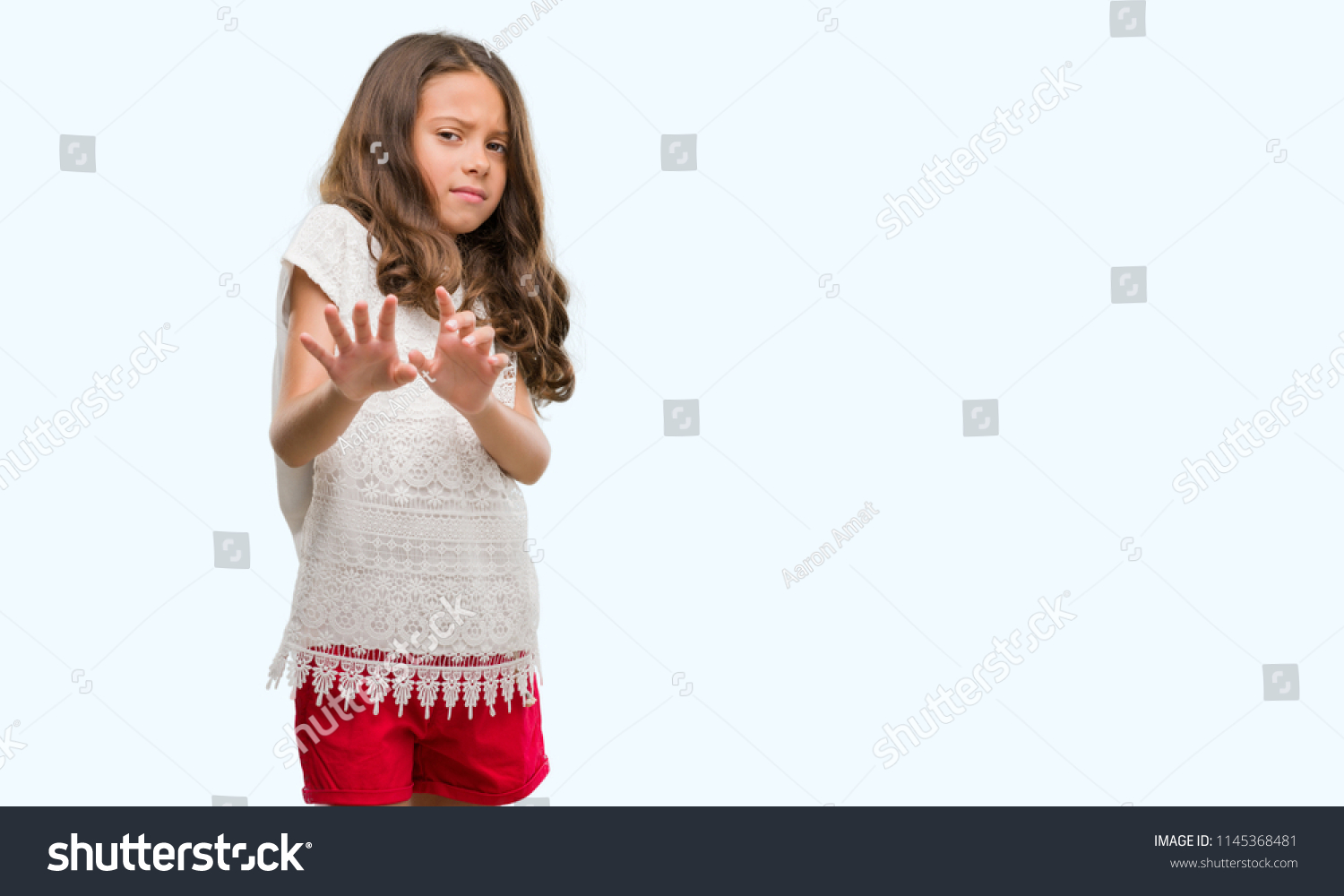 brunette hispanic girl disgusted expression displeased stock photo