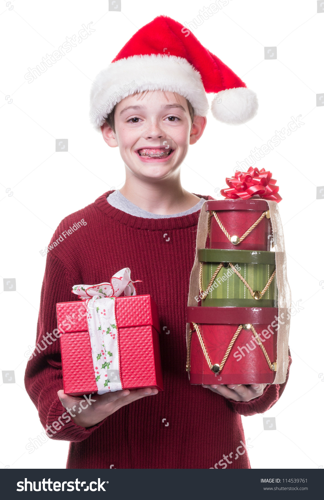 Teen Boy Christmas.Teen Boy Santa Hat Christmas Gifts Stock Photo Edit Now