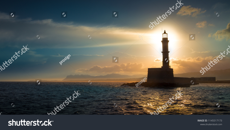 A beautiful night sky behind a shining lighthouse. Chania, Crete, Greece #1145517173