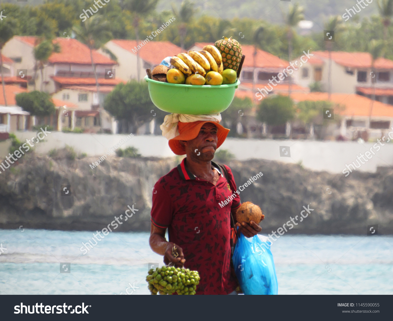 Sosua/Dominican republic, July 26,  2018: Fruit salesman vendor on the beach