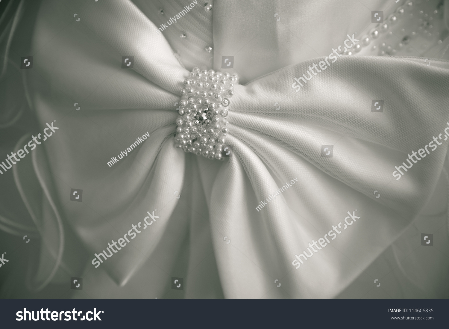 Big Bow On A Wedding Dress. Simple Background. Decorate