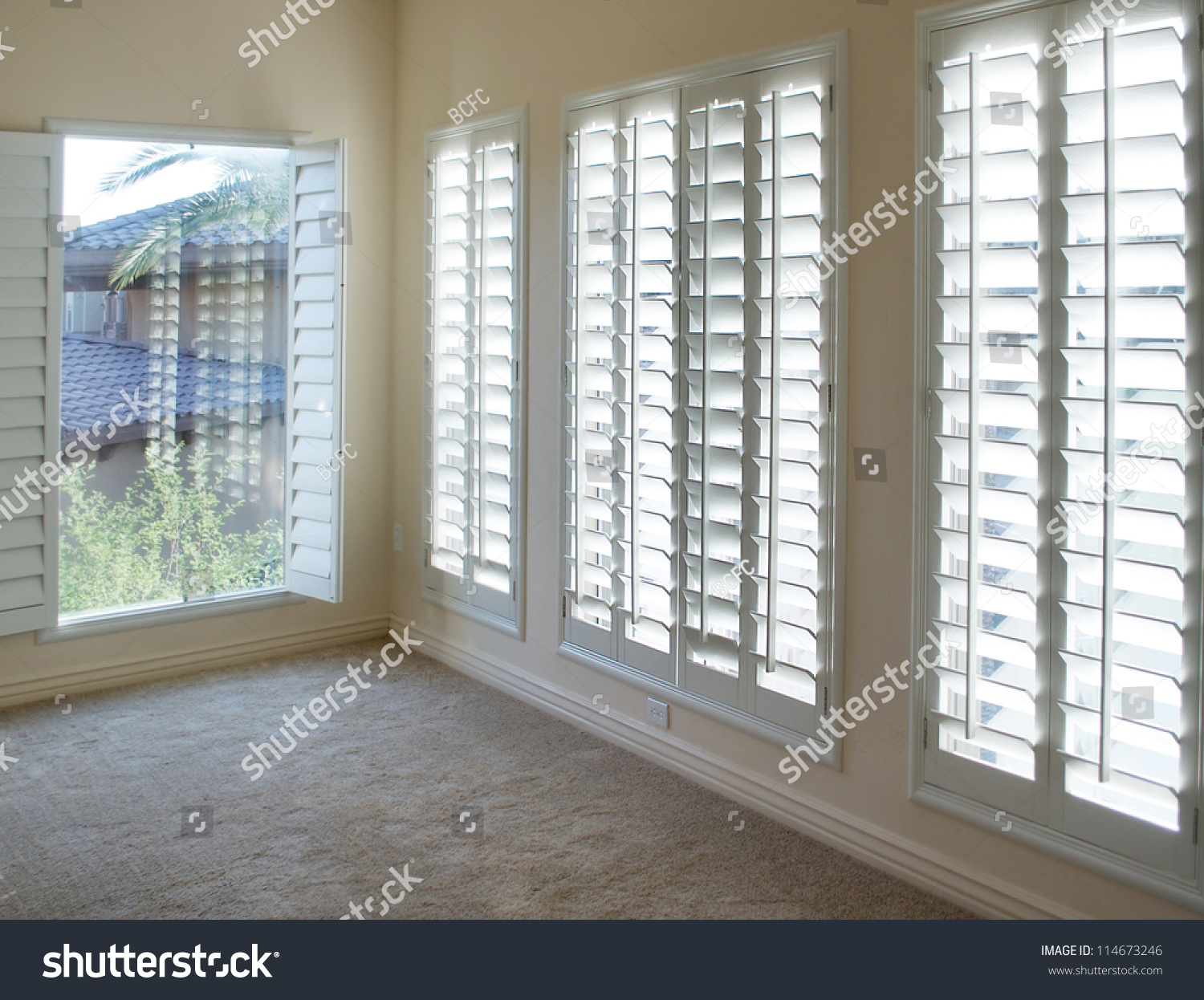 White plantation style wood shutters luxury stock photo for Indoor wood shutters white