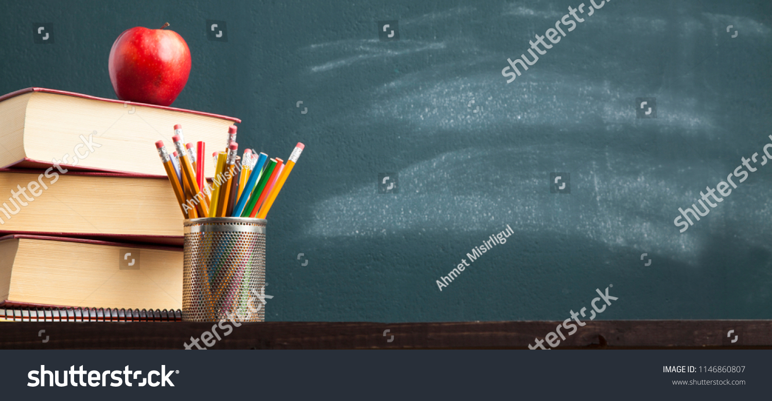 Back to school background with books and apple over blackboard #1146860807