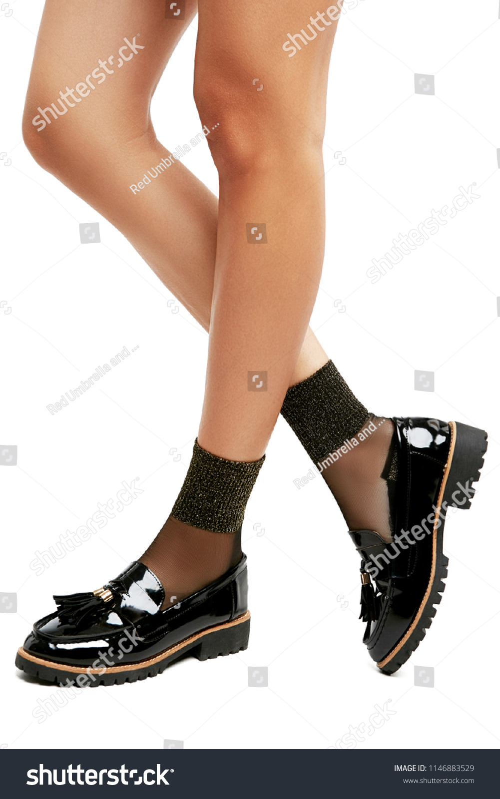 322e27ef1829 Cropped side view of lean woman s legs in sheer ankle high socks with  glitter metallic cuffs