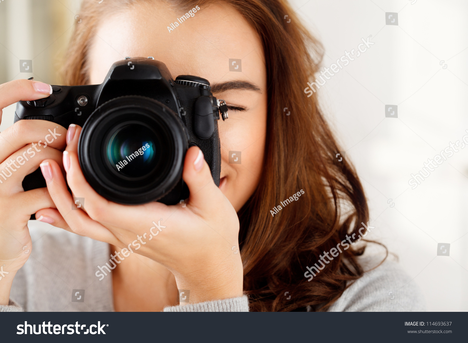 Camera How To Take Good Pictures With Dslr Camera photographer woman girl holding dslr camera stock photo 114693637 is taking photographs