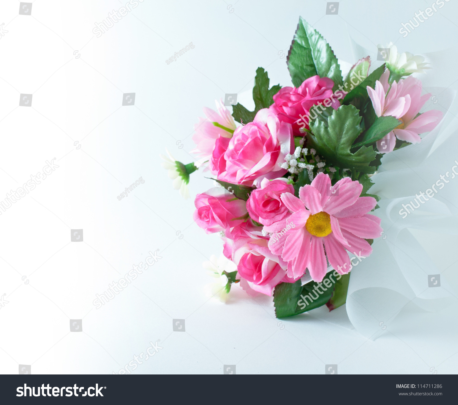Bouquet fake flowers stock photo royalty free 114711286 shutterstock bouquet of fake flowers izmirmasajfo Images