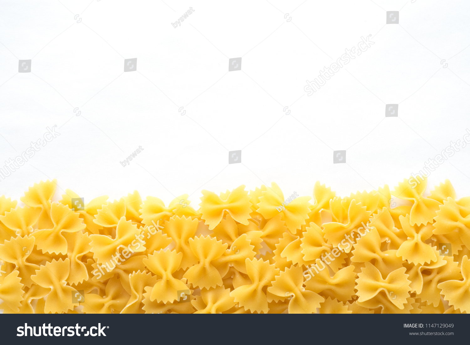 farfalle Raw farfallini Beautiful decomposed pasta with a bottom on a white  isolated background. Close