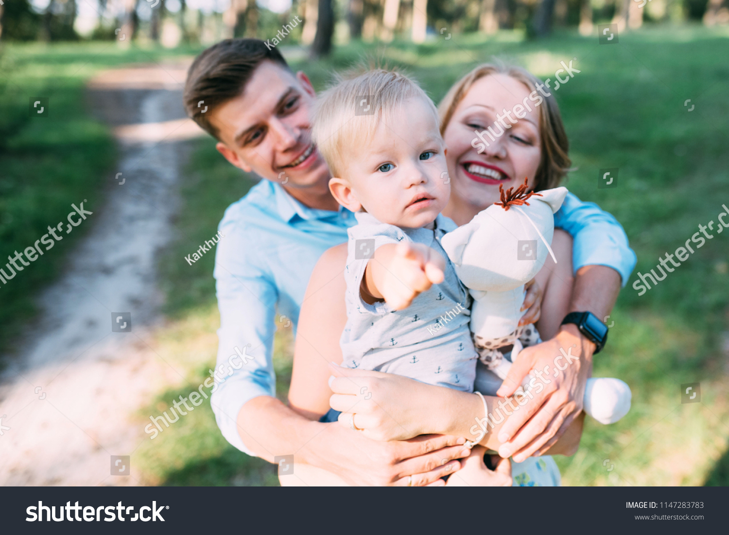 A cute family mom dad and son spend fun time in nature