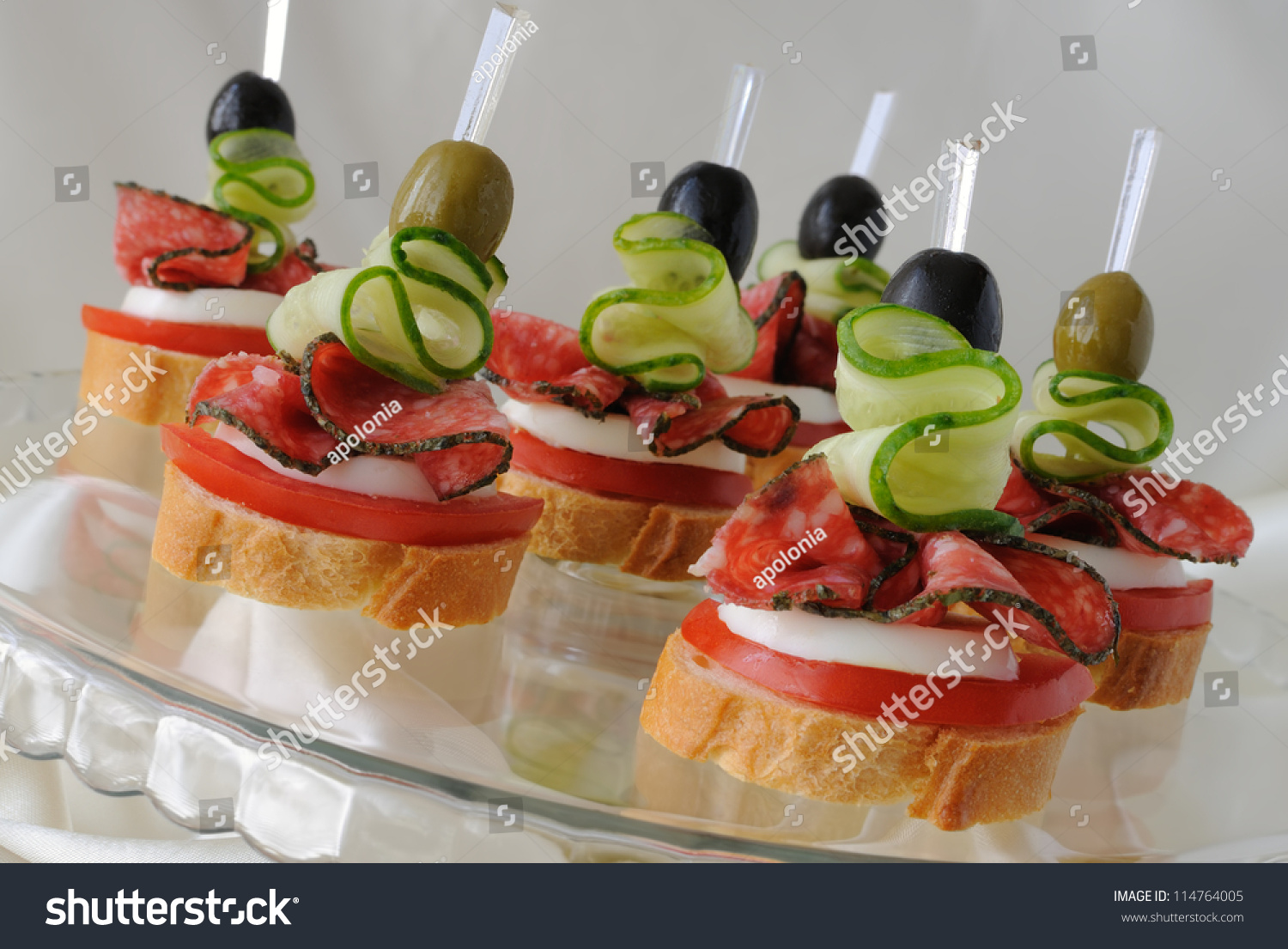 Canape baguette salami on glass base stock photo 114764005 for Canape orientale