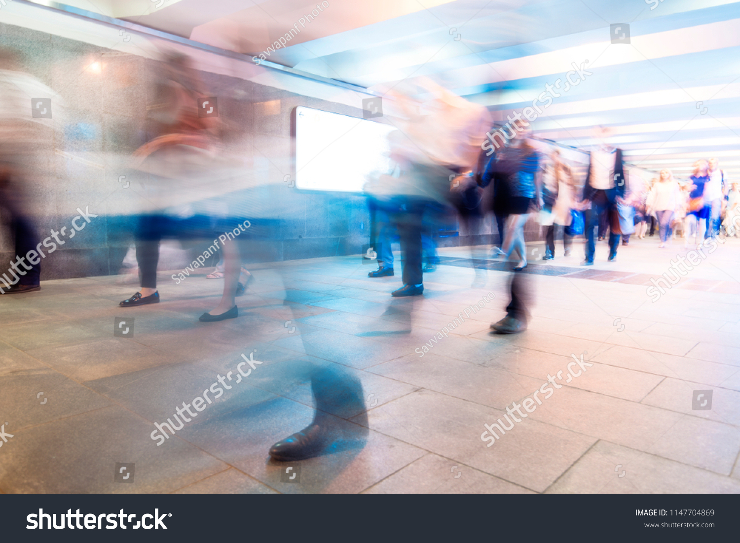 Crowd of People as Pedestrians in Metro, blurred Picture as Background #1147704869