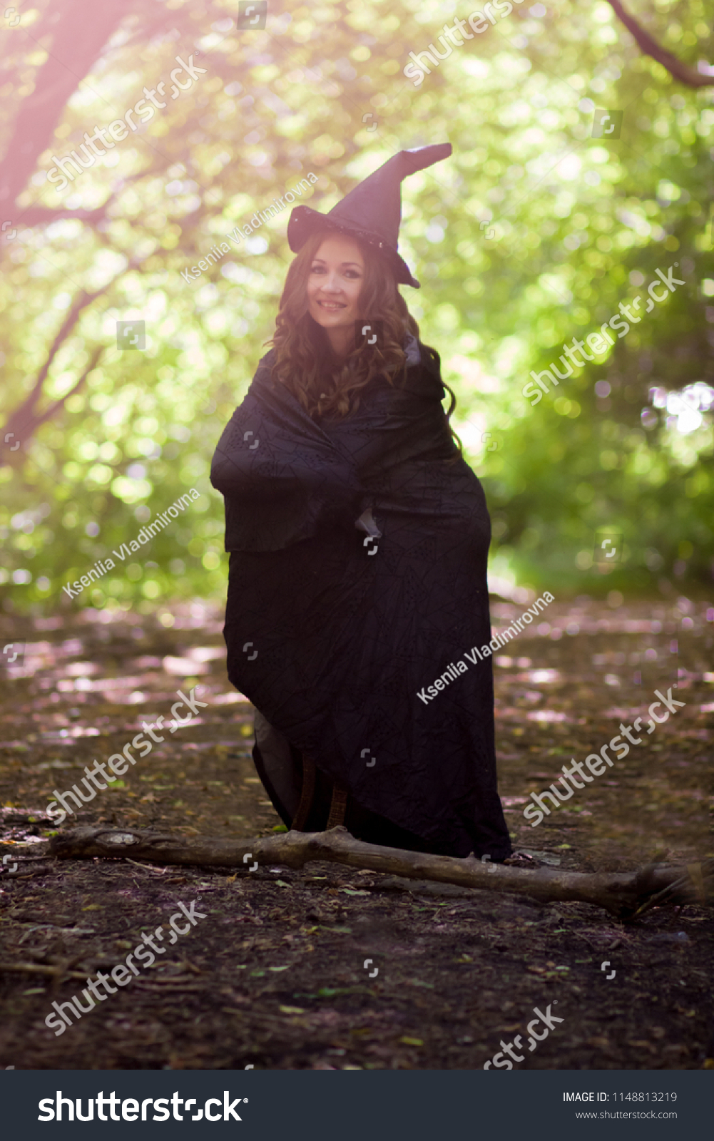 37dc554b078 Halloween. young attractive witch with a smile. small witch. not high. dwarf  in a hat and raincoat - Image
