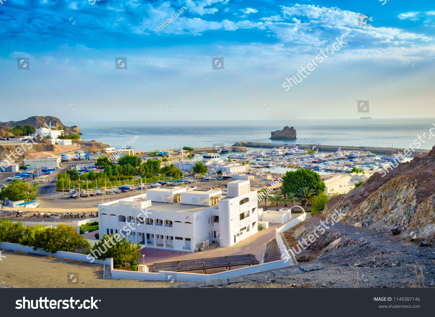 Top view of Oman seascape with blue sky and mountains.