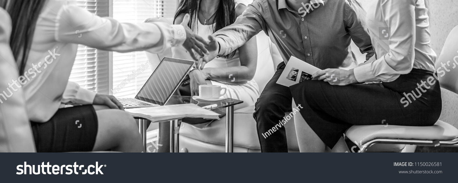 Group of business people at work black-white photo. Employers hands close-up. #1150026581
