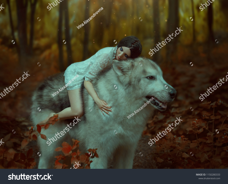 A fragile girl riding a wolf, like Princess Mononoke. Sleeping Beauty.  Alaskan Malamute