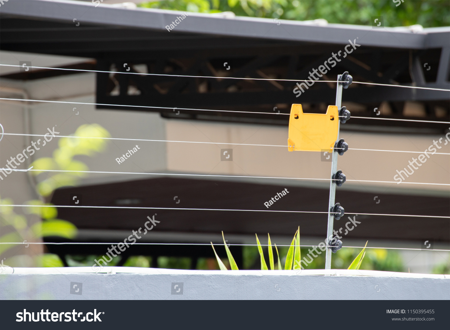 High Voltage Security Fence On House Stock Photo (Royalty Free ...