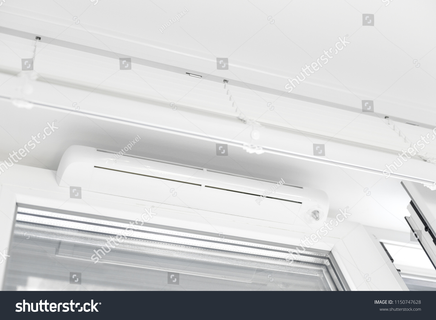 Double glazed window with ventilation unit. Closeup. Nobody #1150747628