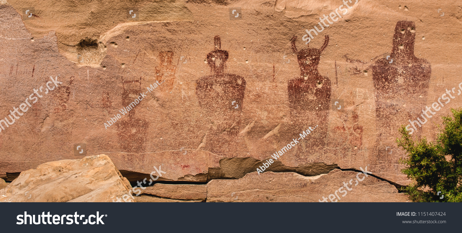 "Ancestral Puebloan or Anasazi petroglyphs of strange anthropomorph figures, often referred to as ""ancient aliens"" on the wall of Sego Canyon in Thompson Springs, Utah.   #1151407424"