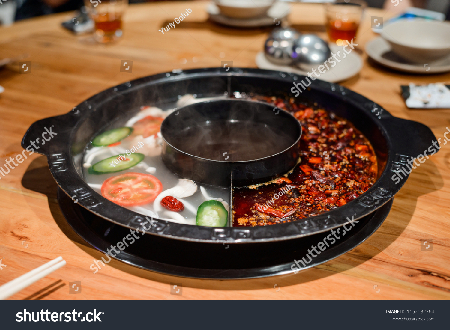 Chinese hot pot with two broth flavors - spicy and mild. Traditional Asian  food and
