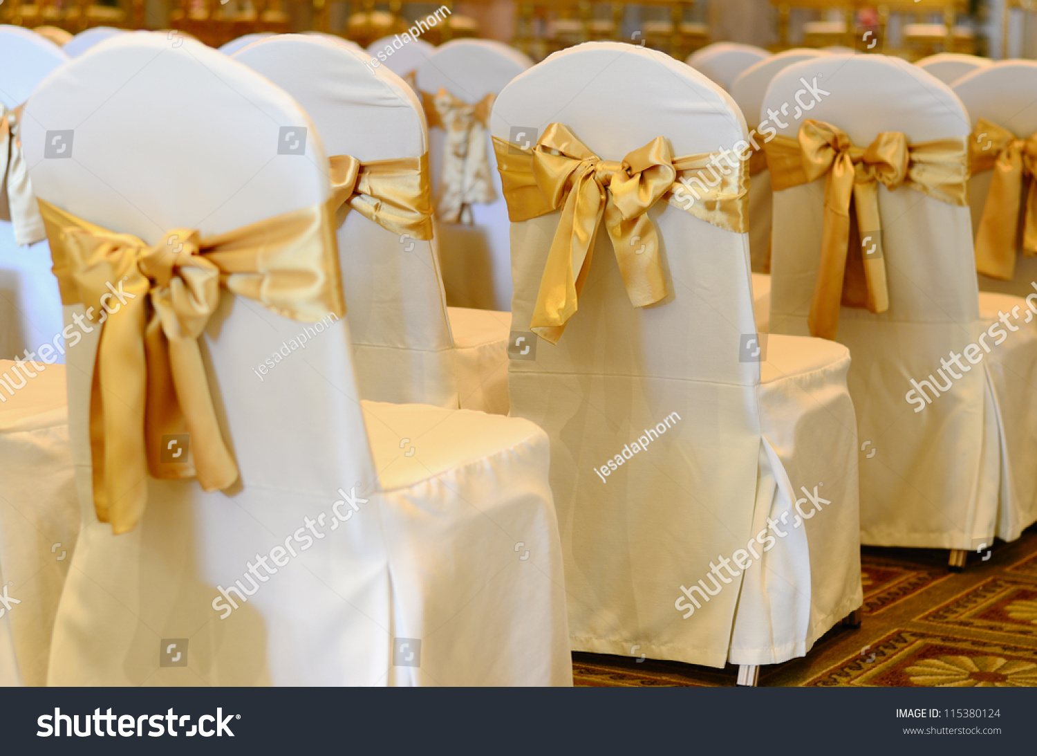 White Chairs At A Wedding Indoor Stock Photo: Wedding Chairs Row Decorated Golden Color Stock Photo
