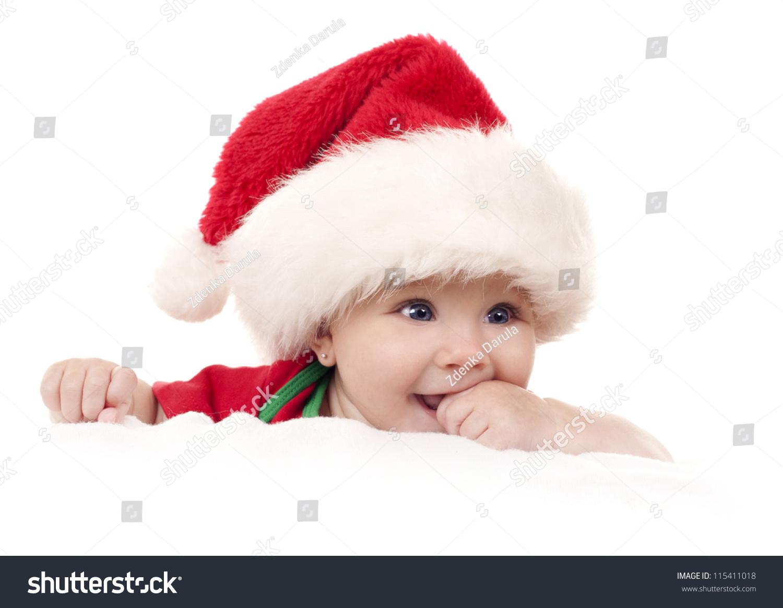 6c0c7a9e4e1 baby girl wearing santa hat on white isolated background