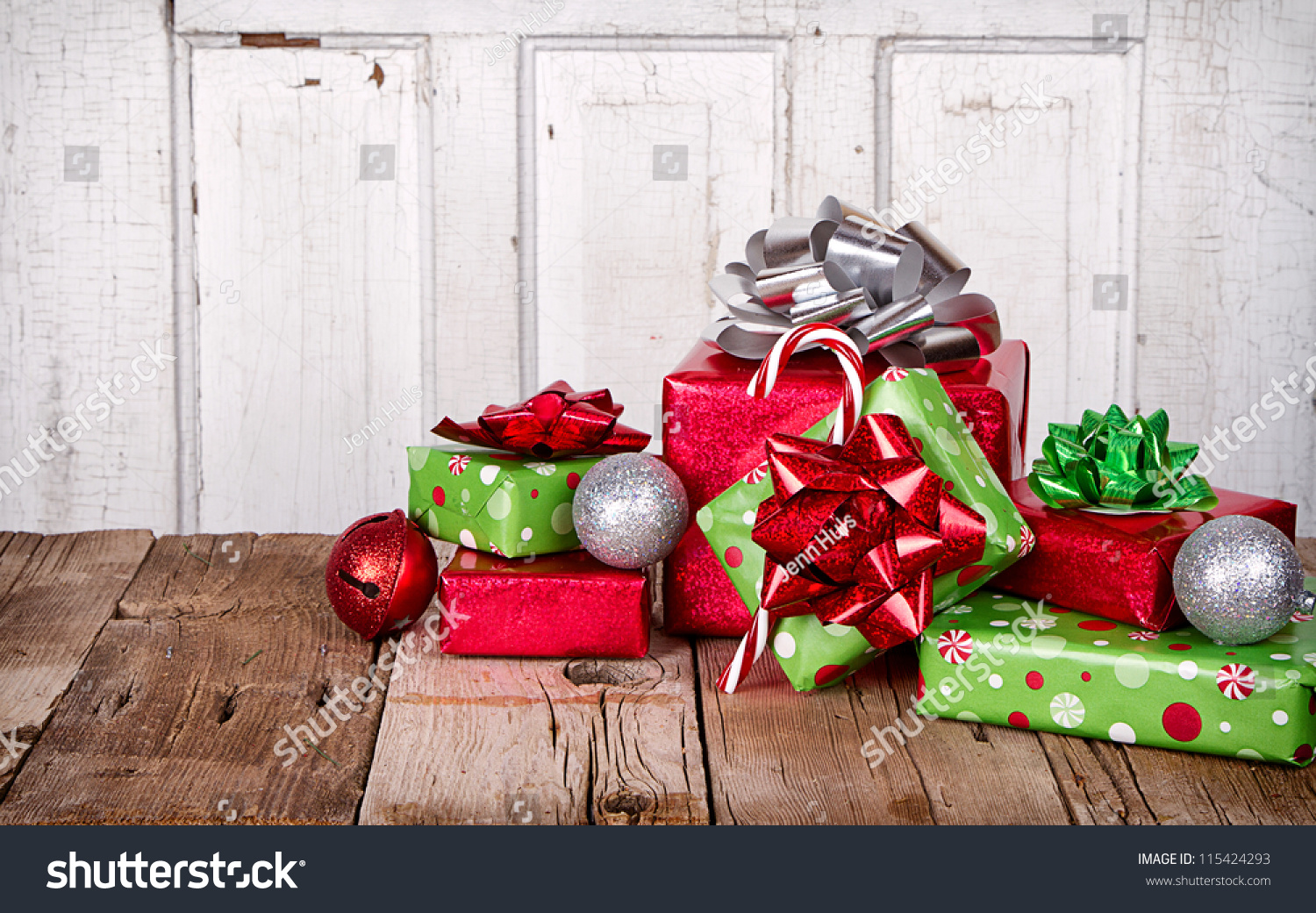 Christmas presents ornaments on wooden background stock