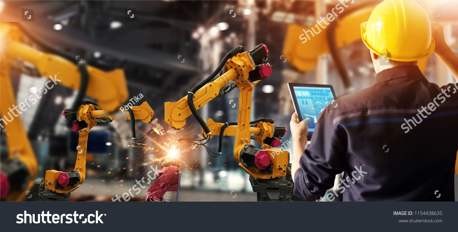 Engineer check and control welding robotics automatic arms machine in intelligent factory automotive industrial with monitoring system software. Digital manufacturing operation. Industry 4.0 #1154438635