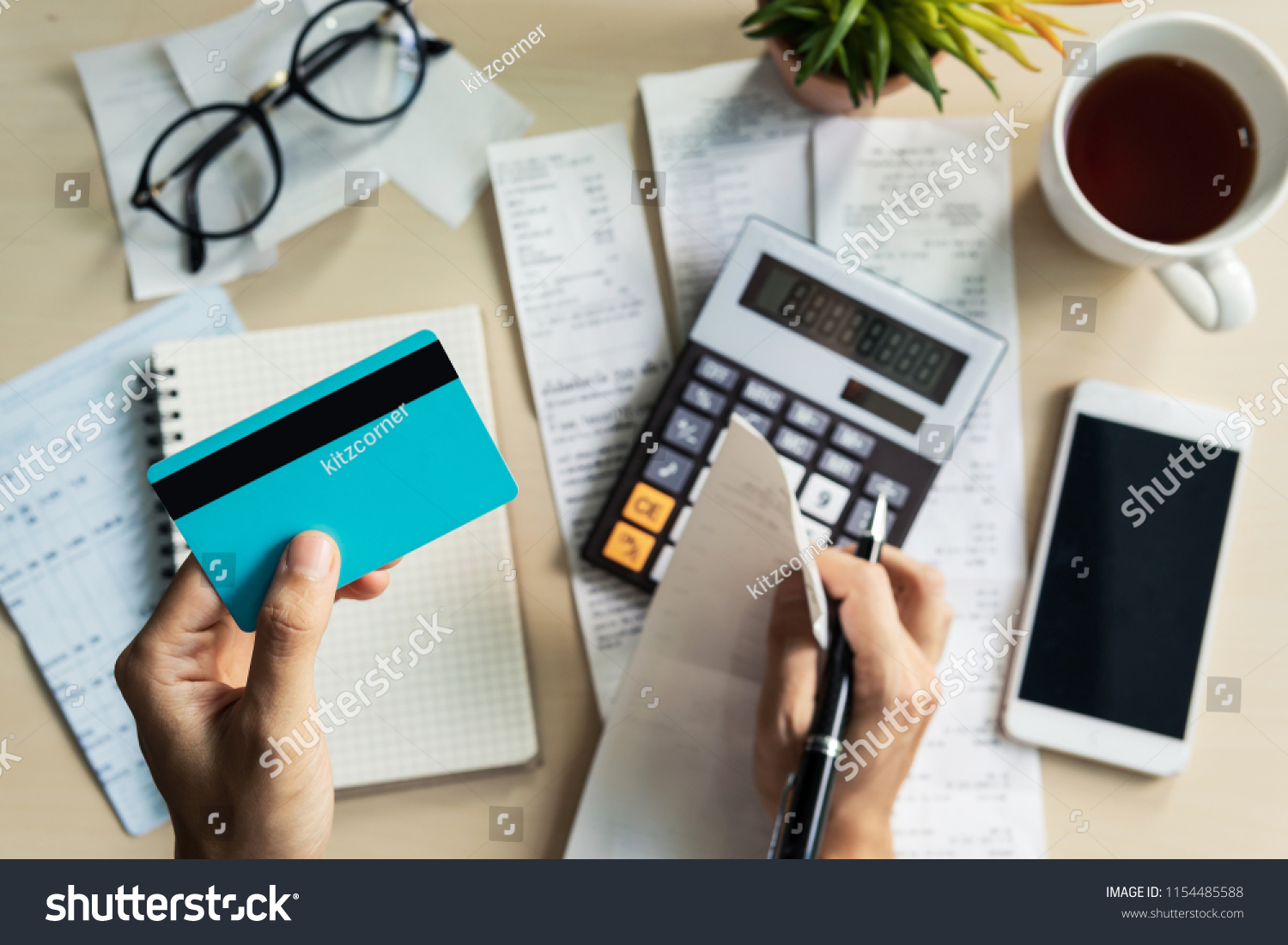 Stressed young woman calculating monthly home expenses, taxes, bank account balance and credit card bills payment, Income is not enough for expenses. #1154485588