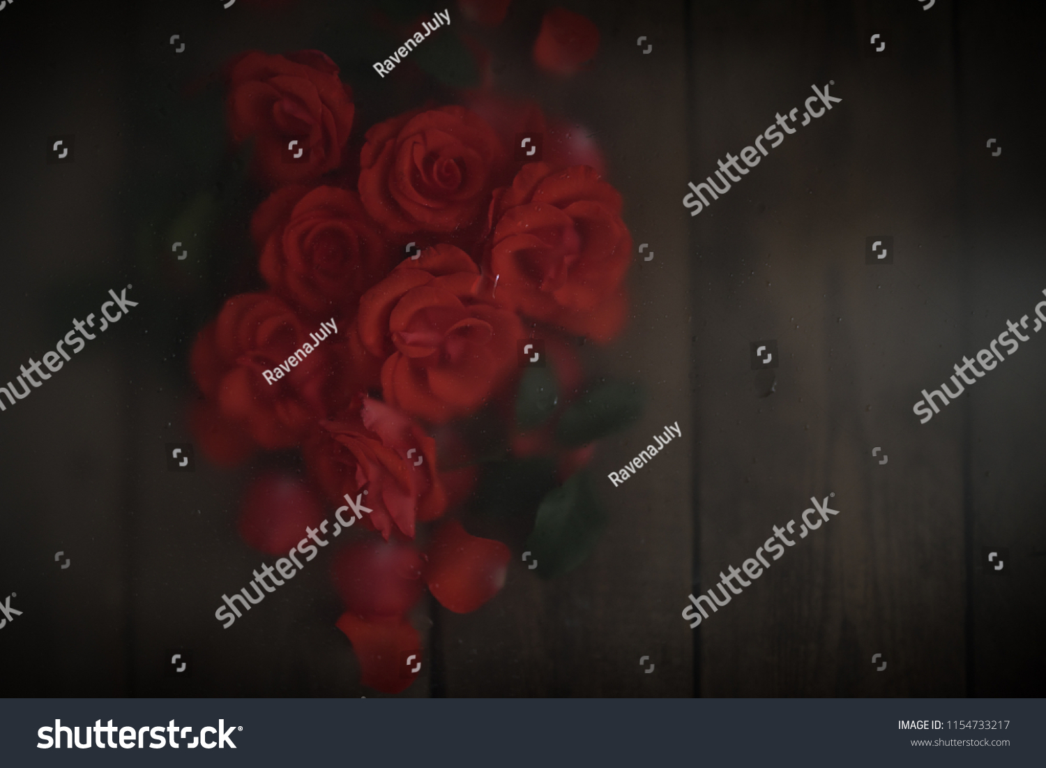 Red roses on a wooden table flat lay, unfocused background. Copy space. Blur