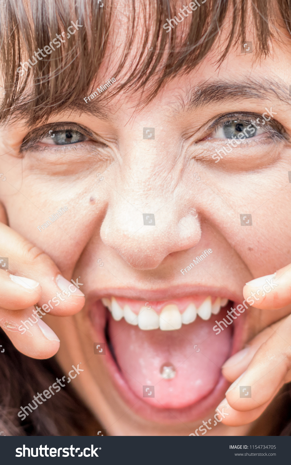 Model Crazy Facial Expression Shows Tongue People Stock Image