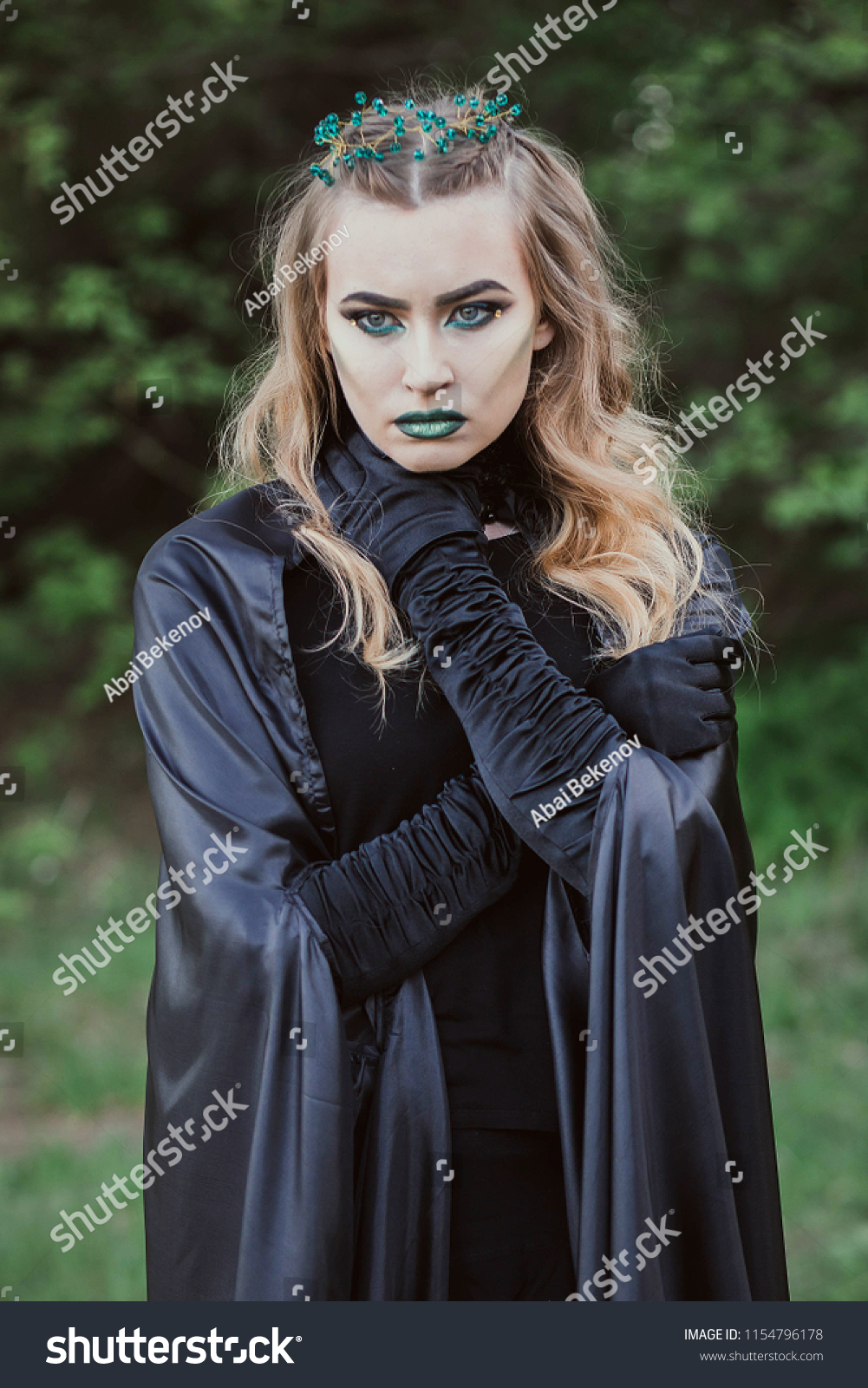 Concept Halloween Witch Black Robes Green Stock Photo Edit Now 1154796178