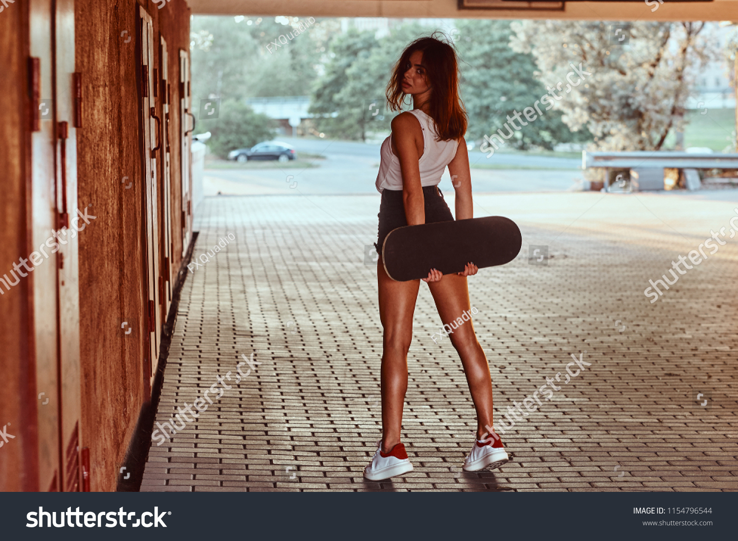 Back view sensual young skater girl stock photo edit now