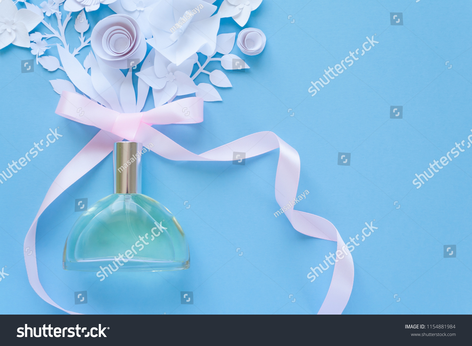 Flower arrangement flowers fragrance perfume pink stock photo edit flower arrangement flowers fragrance perfume with pink ribbon on blue background cut izmirmasajfo