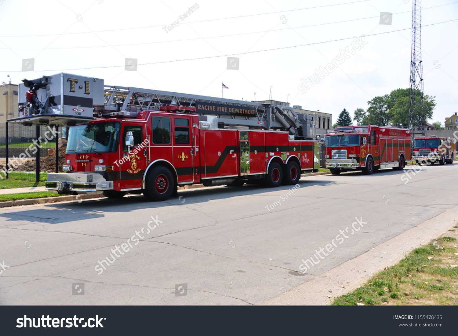 Racine, Wisconsin / USA - August 13, 2018: Racine Fire Department at North Beach in Racine.  Engine and rescue equipment along the street in front of the water department.