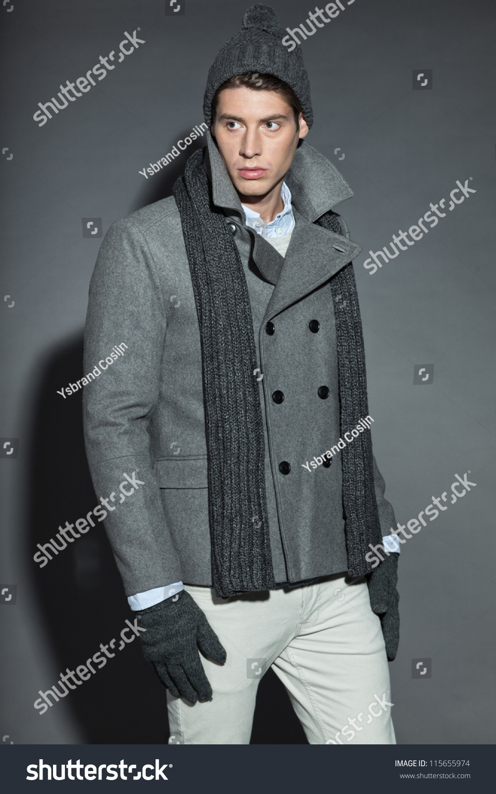 Men winter fashion. Handsome man with brown hair wearing grey scarf 1d71fae3f8b