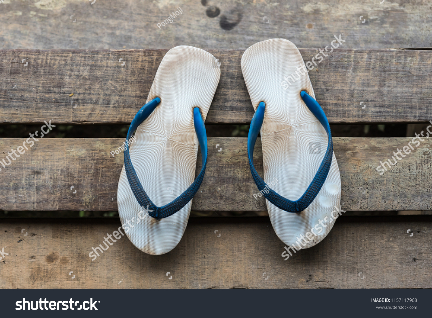 e3b2e4226 Vintage sandal or thongs or flip-flop blue color is a footwear on wooden  staircase