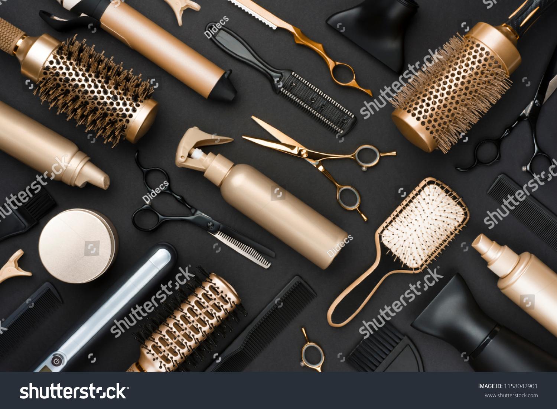 Full frame of professional hair dresser tools on black background #1158042901