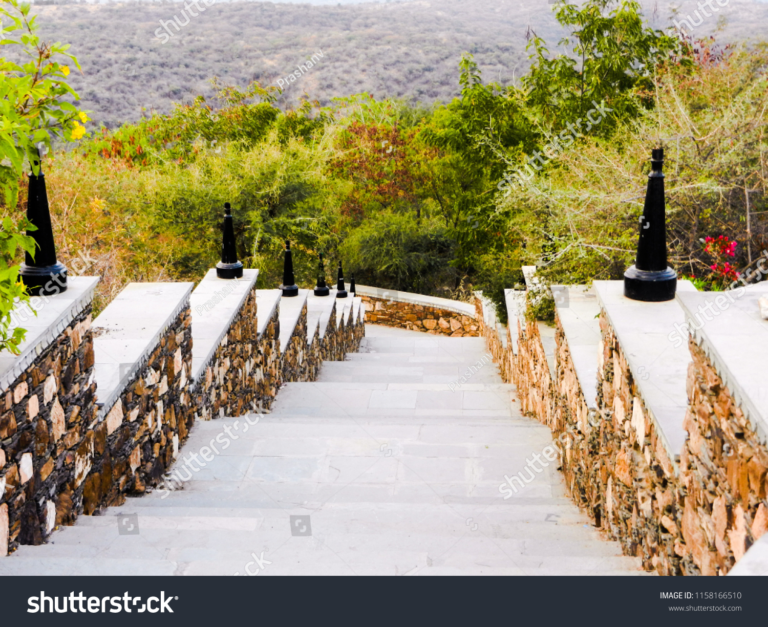 greenery view with rounded downstairs pathway made up of biv brown stones
