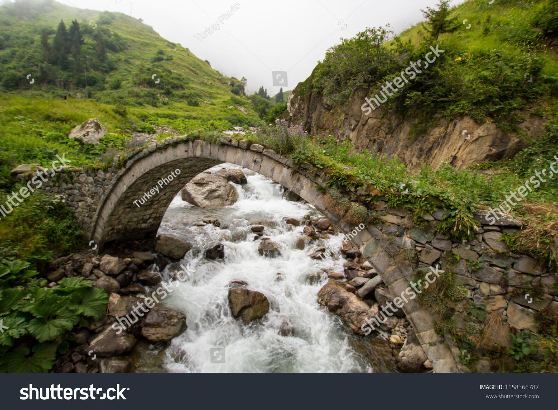 stock-photo-old-historical-stone-bridge-
