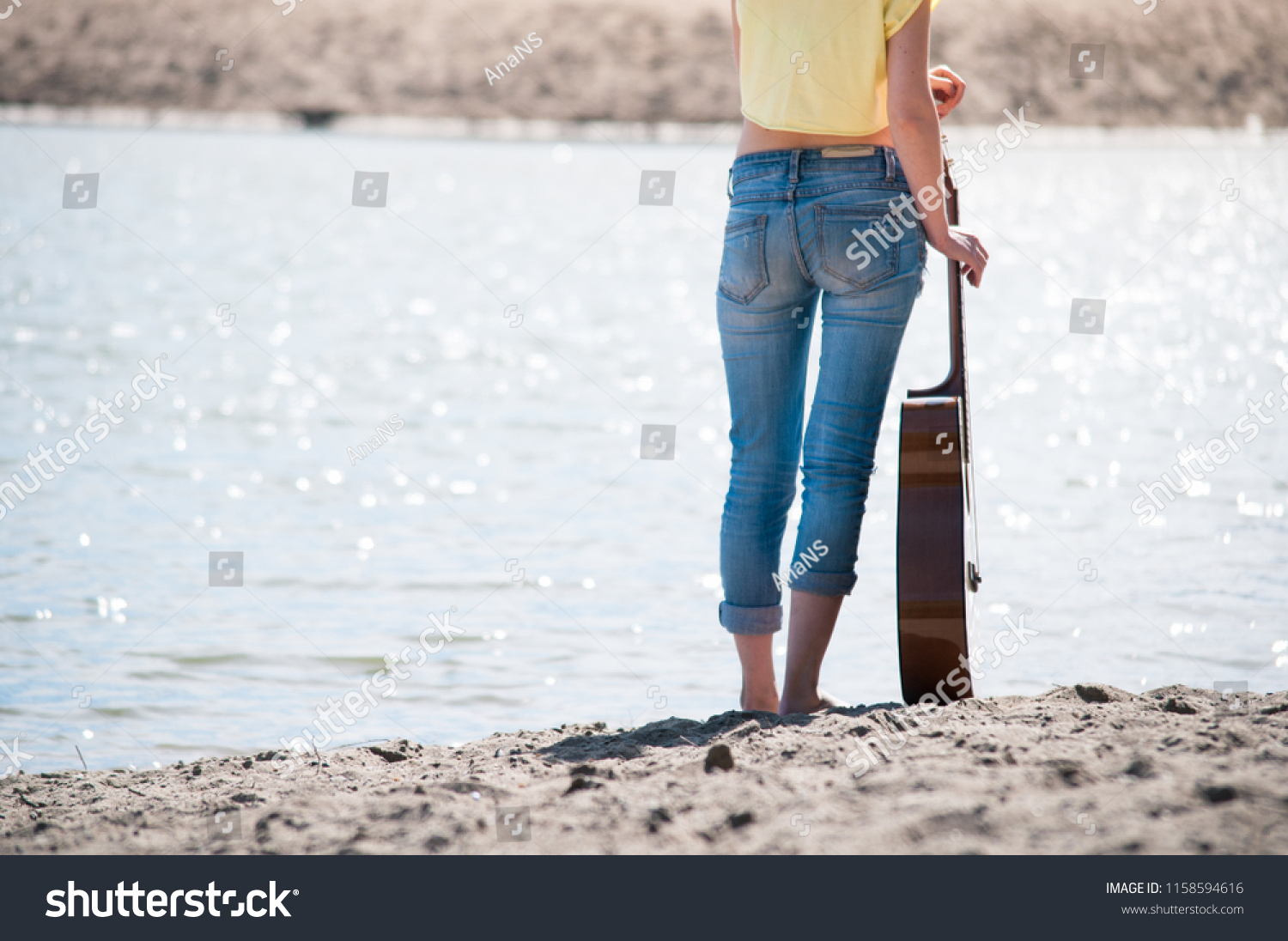 cheaper better clearance prices Pretty Young Woman Wearing Jeans Standing Stock Photo (Edit ...