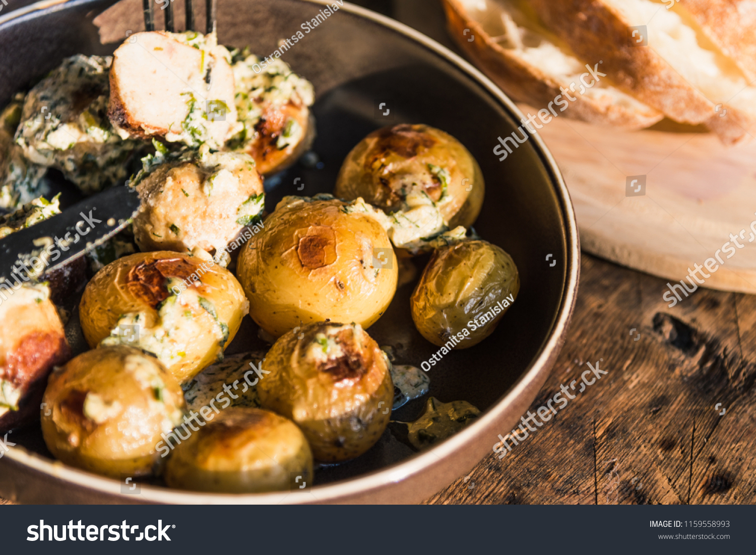 Swedish food - traditional chicken meatballs with cream sauce and new  potatoes on a rustic wooden