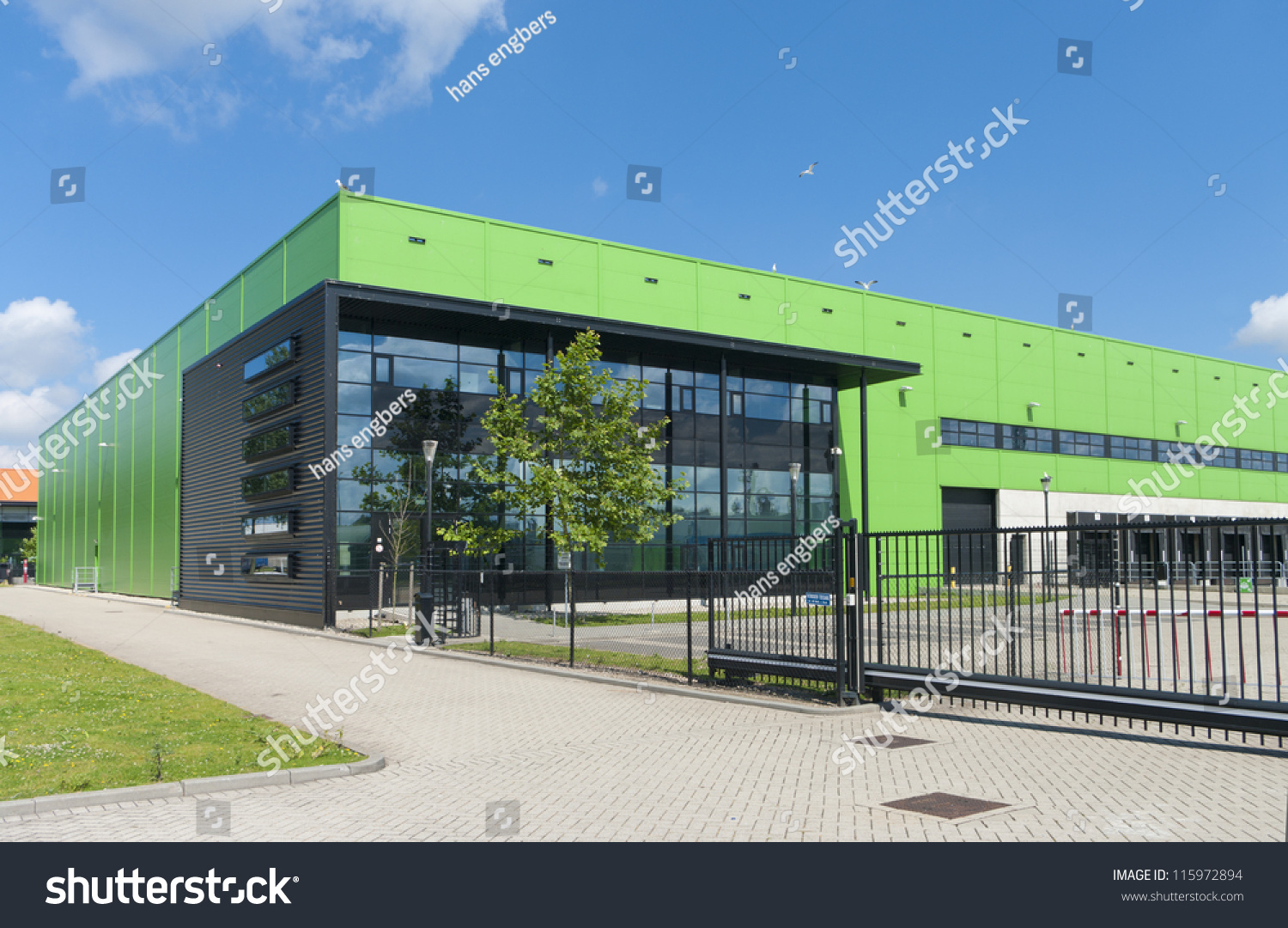 Modern green warehouse rotterdam harbor area stock photo for Modern warehouse designs examples