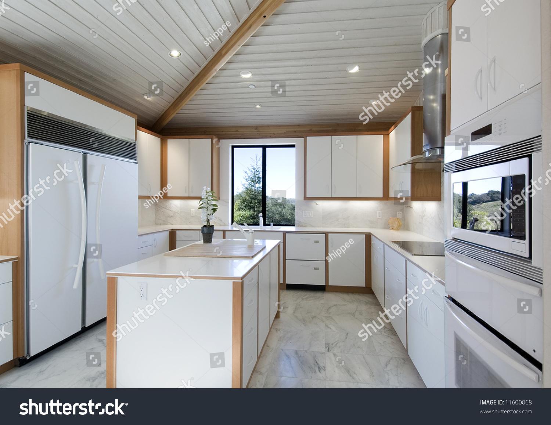 Ultra Modern White Kitchen All The Lates Appliances Center Island White Countertops