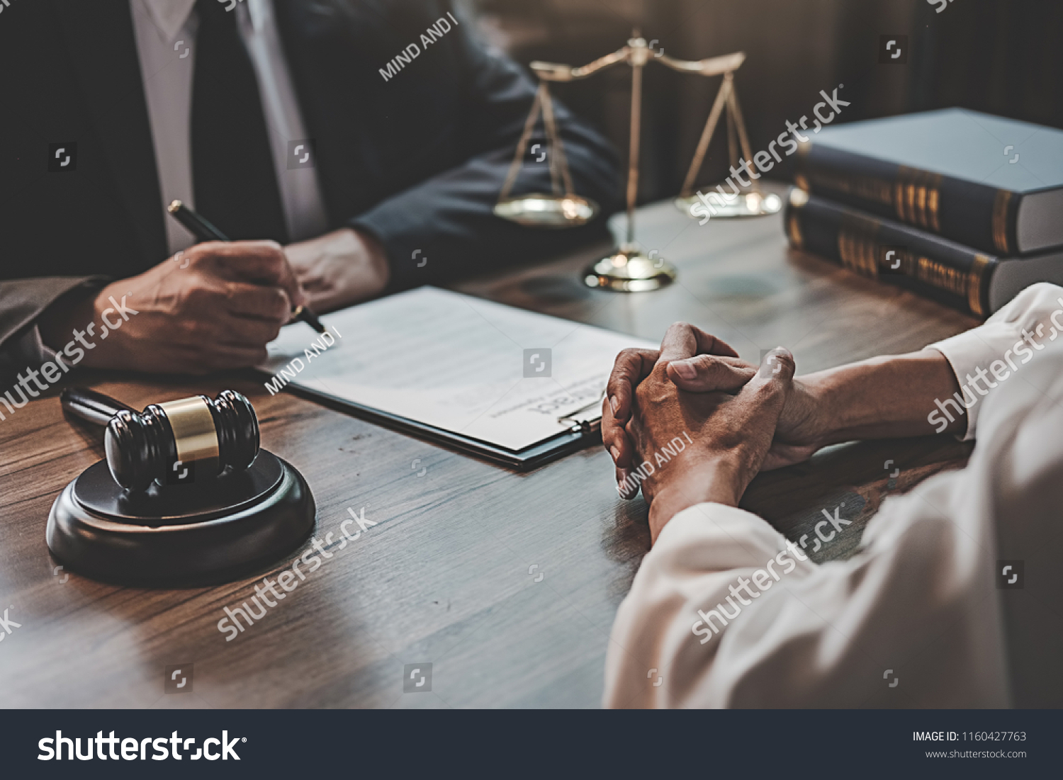 Judge gavel with Justice lawyers having team meeting at law firm background. Concepts of Law and Legal services. #1160427763