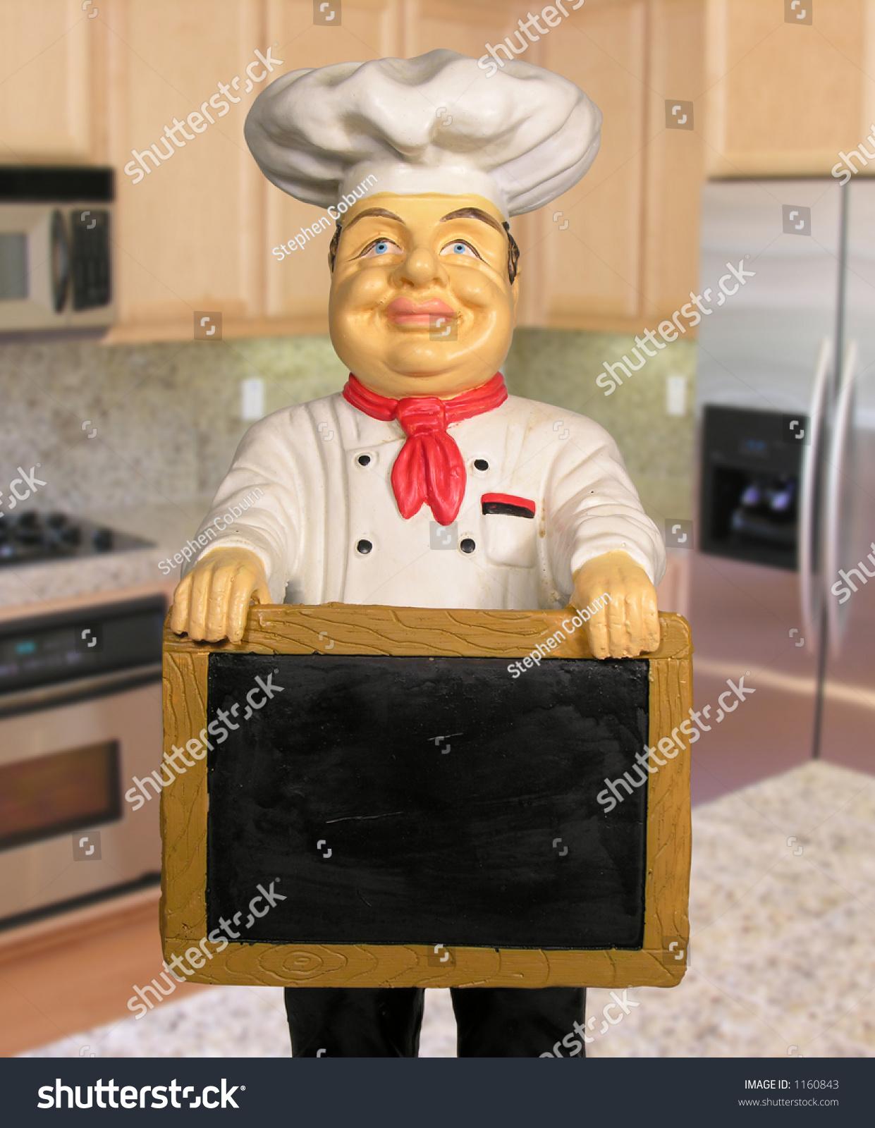 photo chef statue holding menu board stock photo