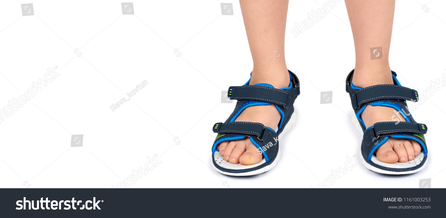 4ef95ed3c3 Kids leather sandals on leg isolated on a white background, copy space  template.