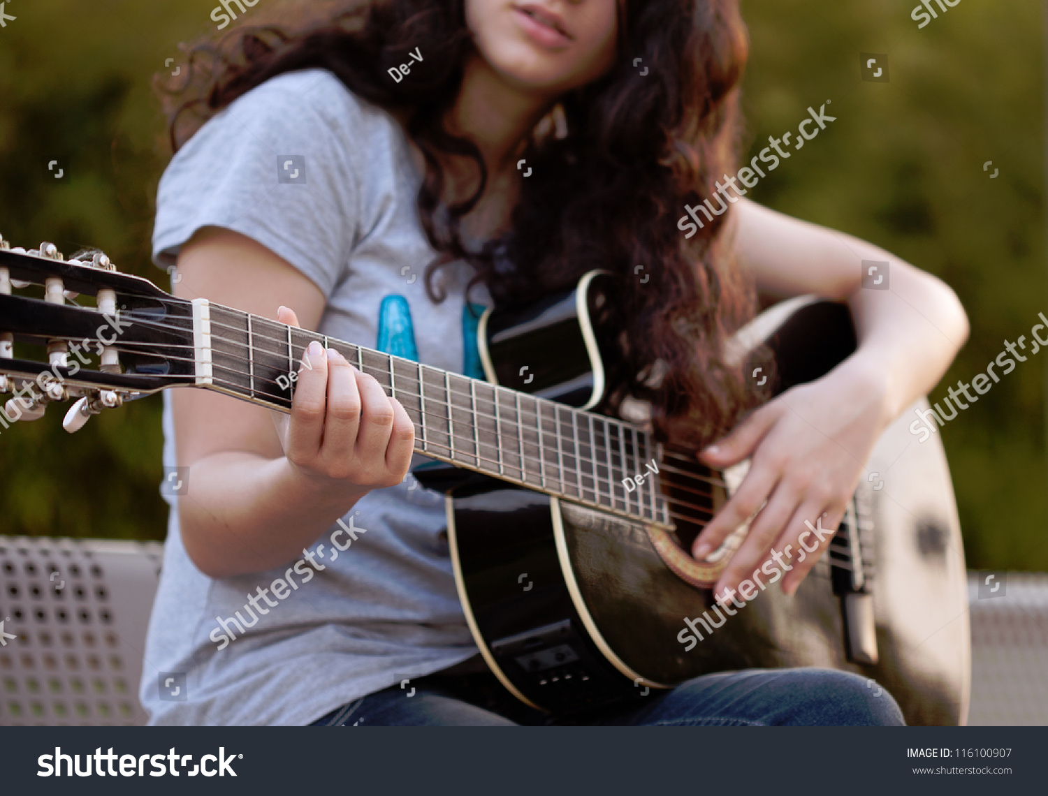 Teenage Girl Playing A...