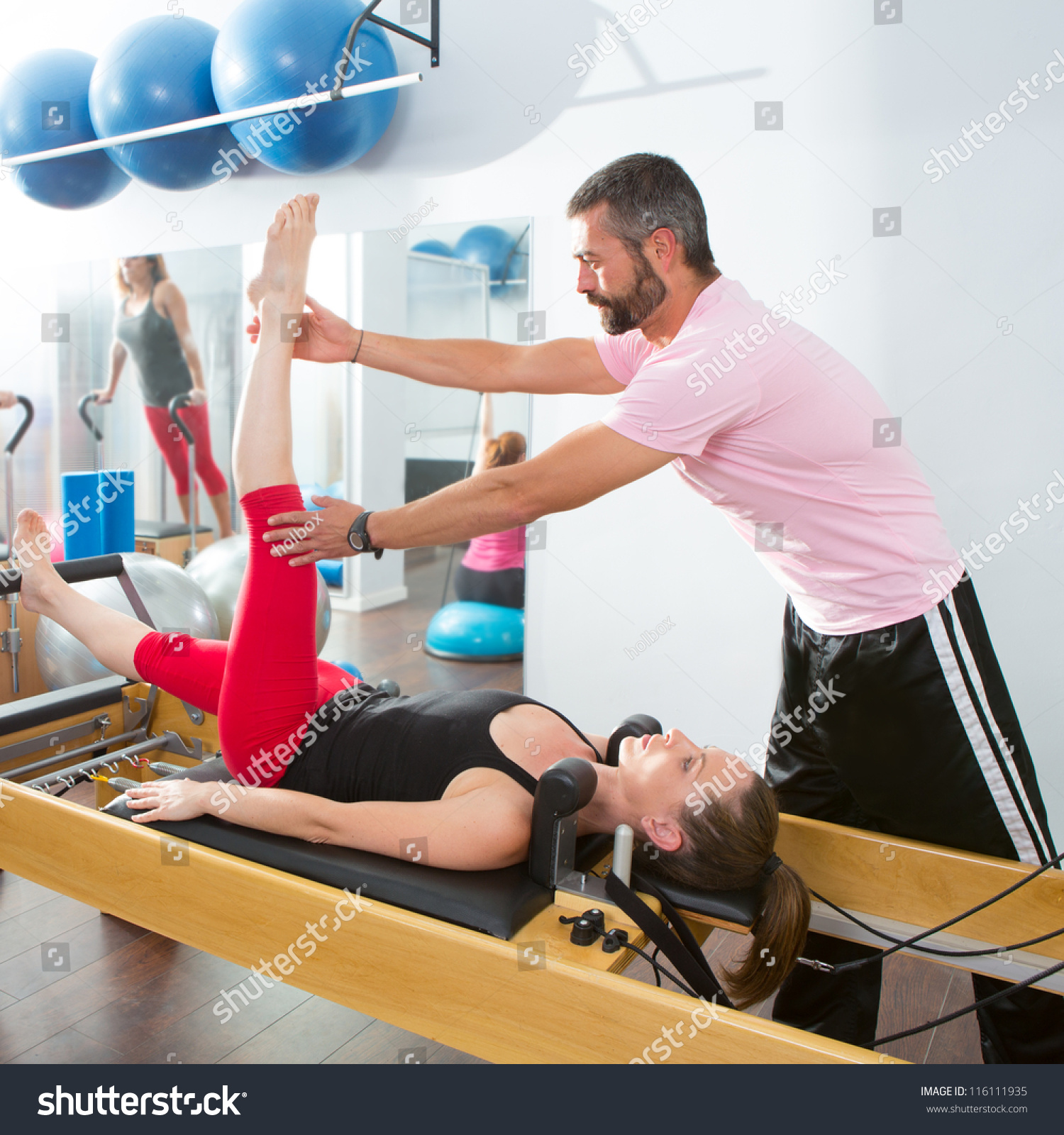 Woman Pilates Chair Exercises Fitness Stock Photo: Pilates Aerobic Personal Trainer Instructor Man In