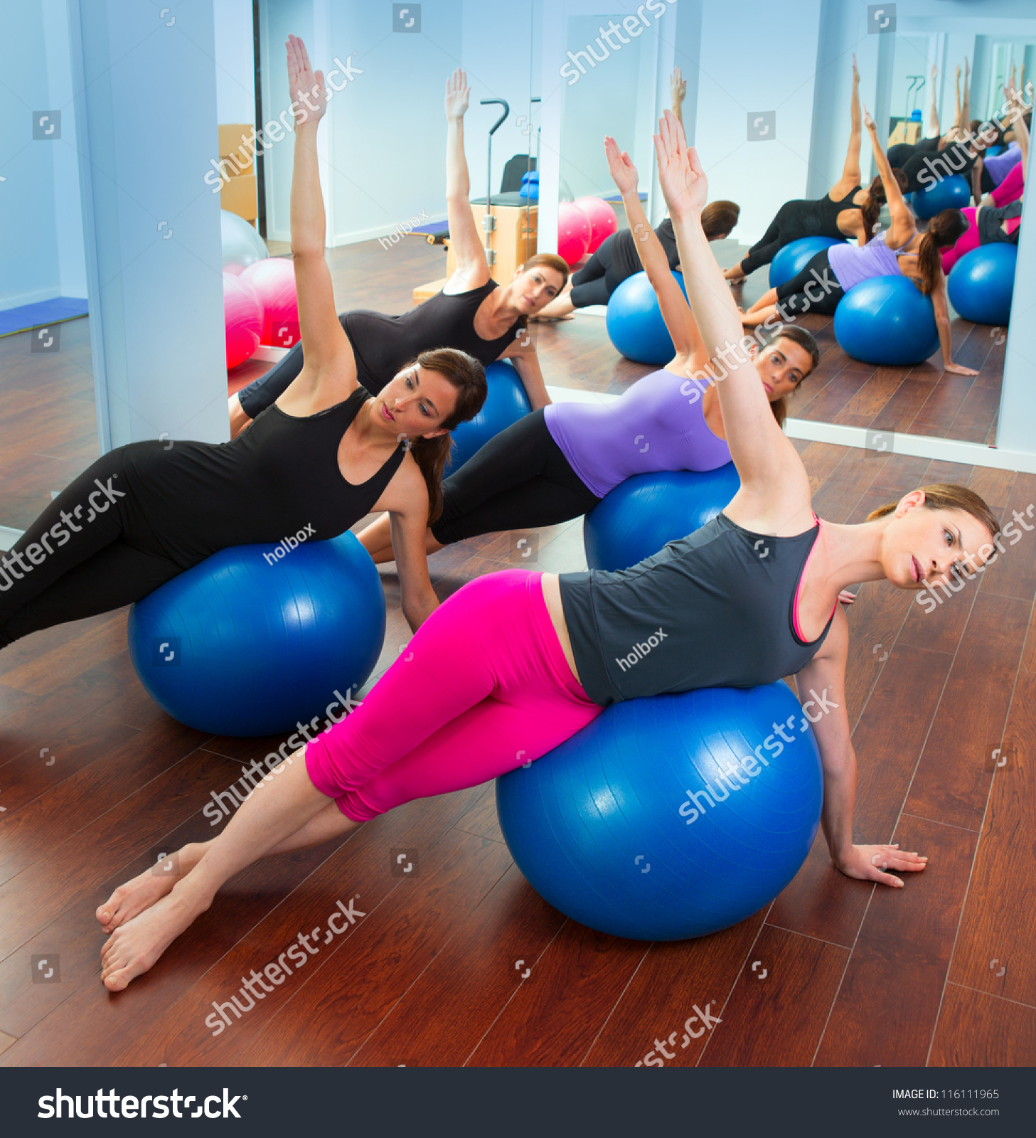 Woman Pilates Chair Exercises Fitness Stock Photo: Pilates Aerobics Women Group With Stability Ball In A Row